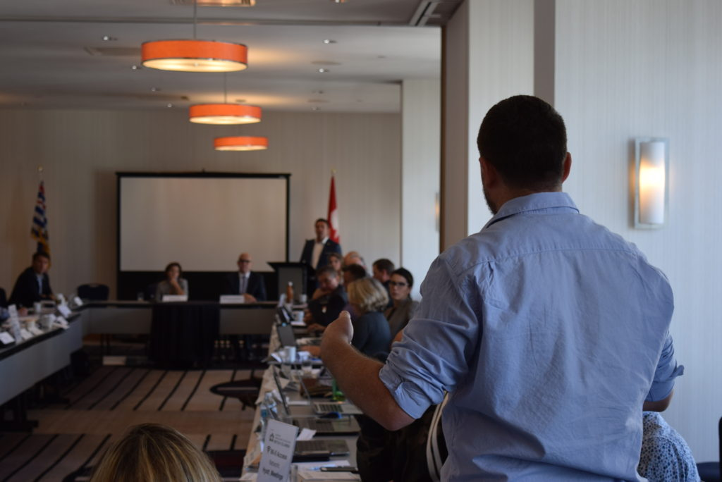 Man gives speech at meeting